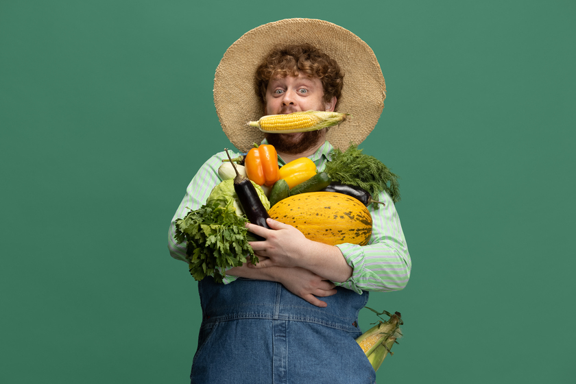 redheaded bearded man farmer with vegetables harvest isolated green studio wall 1